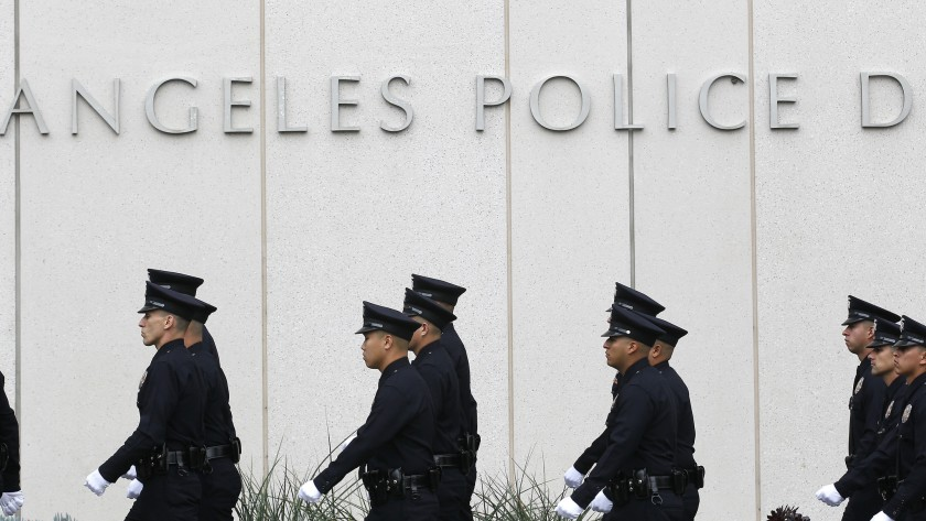 Los Angeles Police Department officers are seen outside the agency's downtown headquarters in this undated photo. (Brian van der Brug / Los Angeles Times)