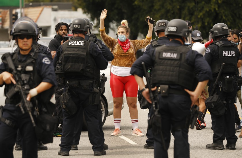 LAPD officers move protesters up Cahuenga Boulevard to Yucca Street in Hollywood.(Al Seib / Los Angeles Times)