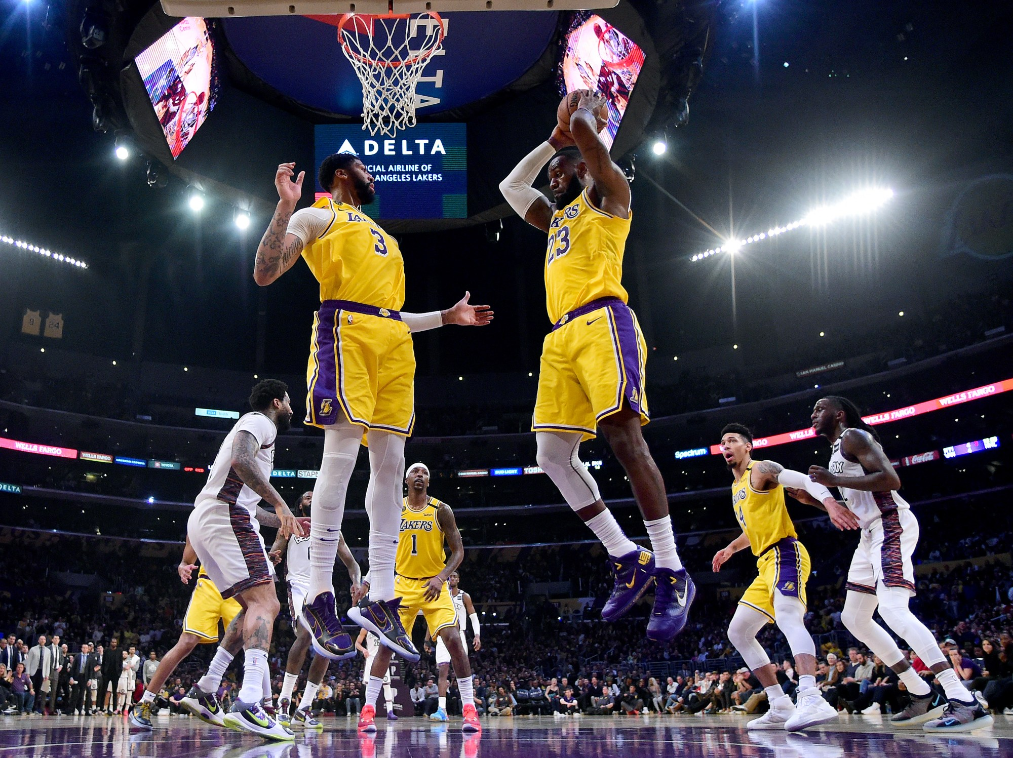LeBron James #23 of the Los Angeles Lakers grabs a rebound in front of Anthony Davis #3 during a 104-102 loss to the Brooklyn Nets at Staples Center on March 10, 2020 in Los Angeles, California. (Harry How/Getty Images)