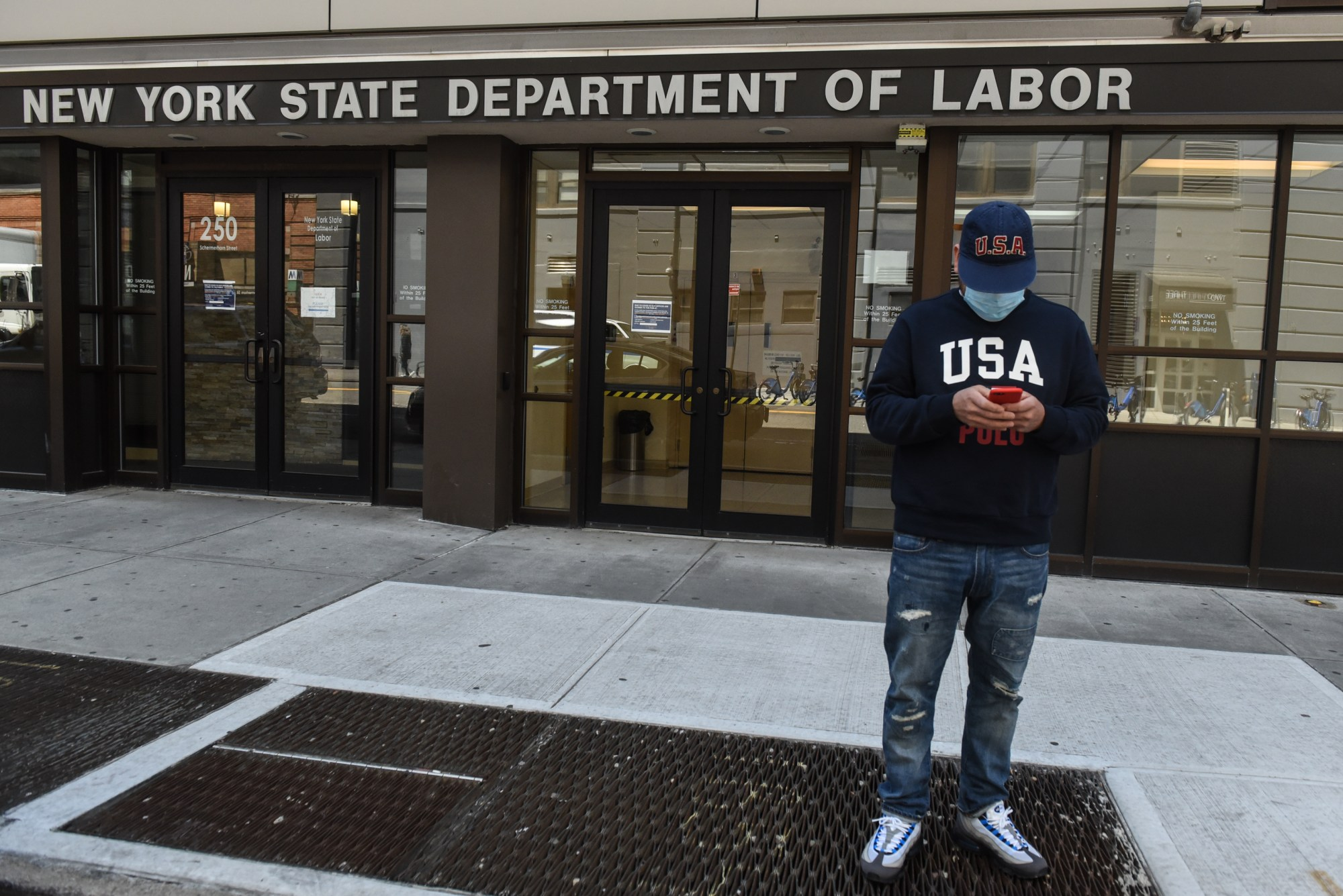 Luis Mora stands in front of the closed offices of the New York State Department of Labor on May 7, 2020 in the Brooklyn borough in New York City. (Stephanie Keith/Getty Images)