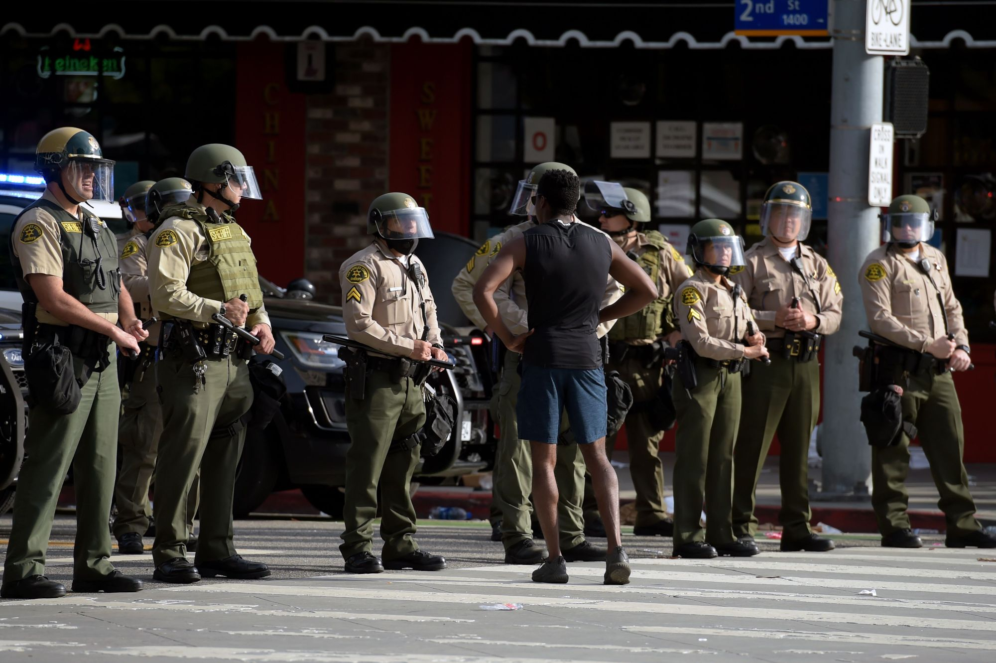 A protester confronts a row of Los Angeles County sheriff's deputies during a demonstration over the death of George Floyd in Santa Monica on May 31, 2020.(AGUSTIN PAULLIER/AFP via Getty Images)