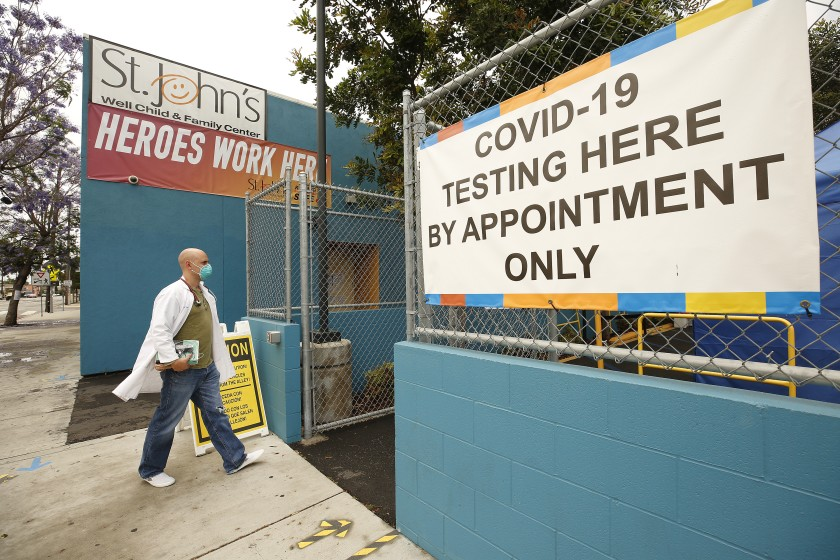 A worker walks into a Los Angeles County coronavirus testing center in this undated photo. (Al Seib/Los Angeles Times)
