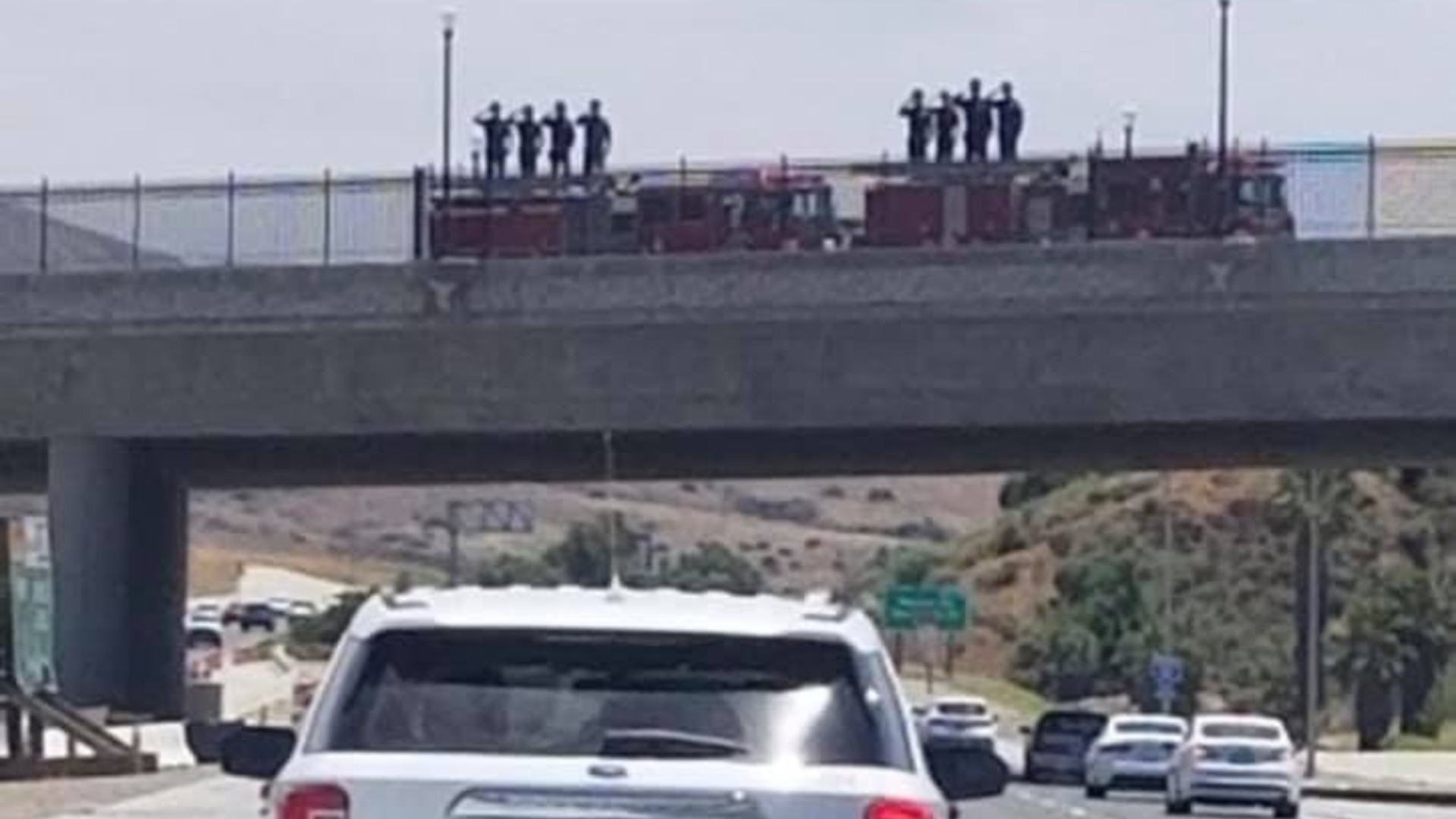 An image of fire department personnel saluting during a procession was posted on the CACorrections Facebook page.