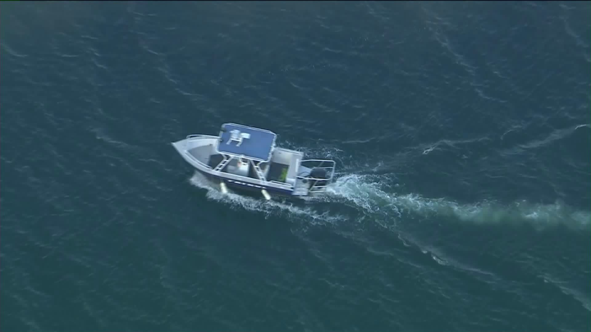 Authorities were searching for a possible drowning victim after a 3-year-old was found on a boat alone in Lake Piru. (KTLA)