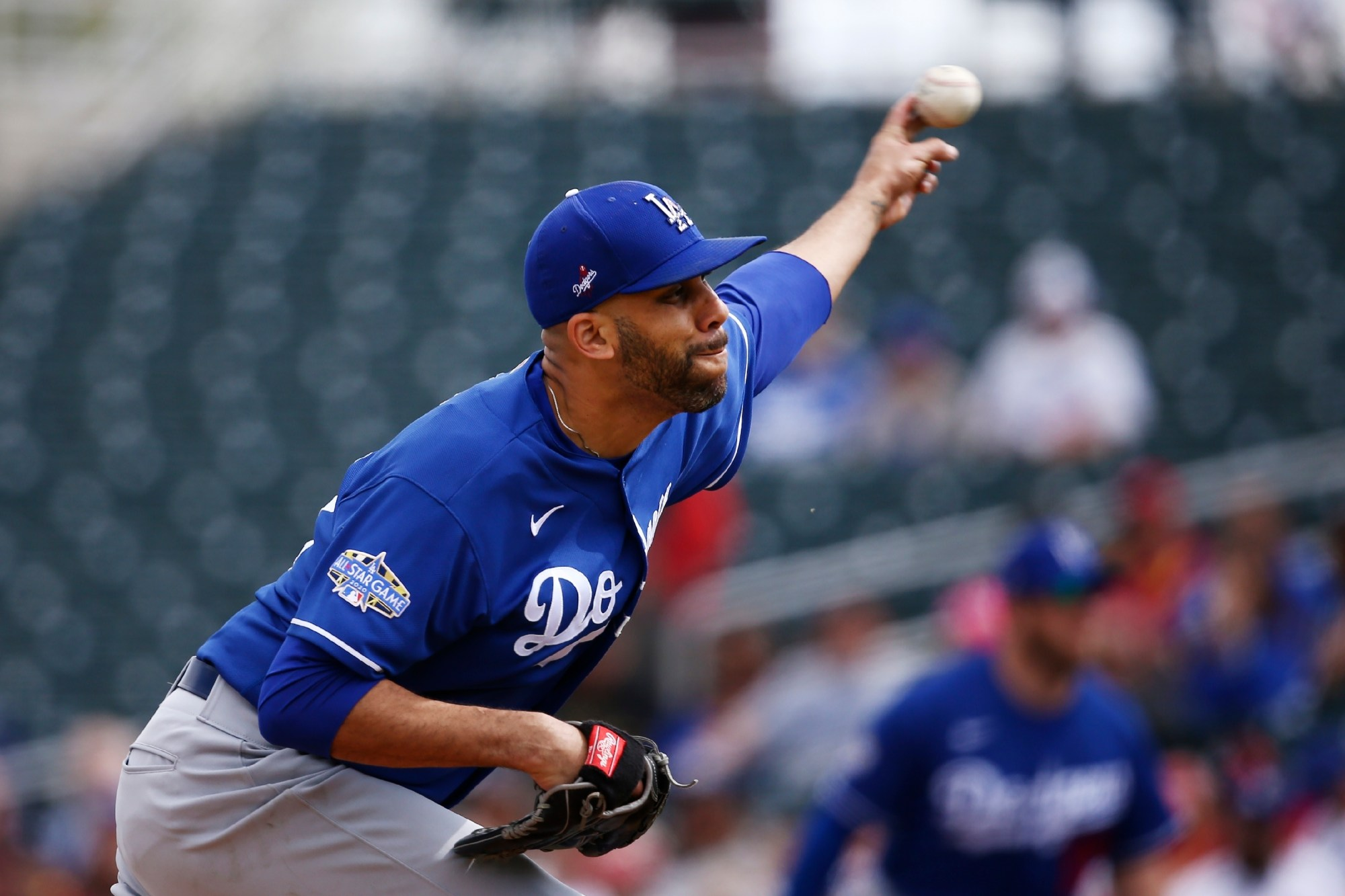 Los Angeles Dodgers starting pitcher David Price throws against the Cincinnati Reds during the first inning of a spring training baseball game in Goodyear, Arizona on March 2, 2020. (AP Photo/Ross D. Franklin, File)