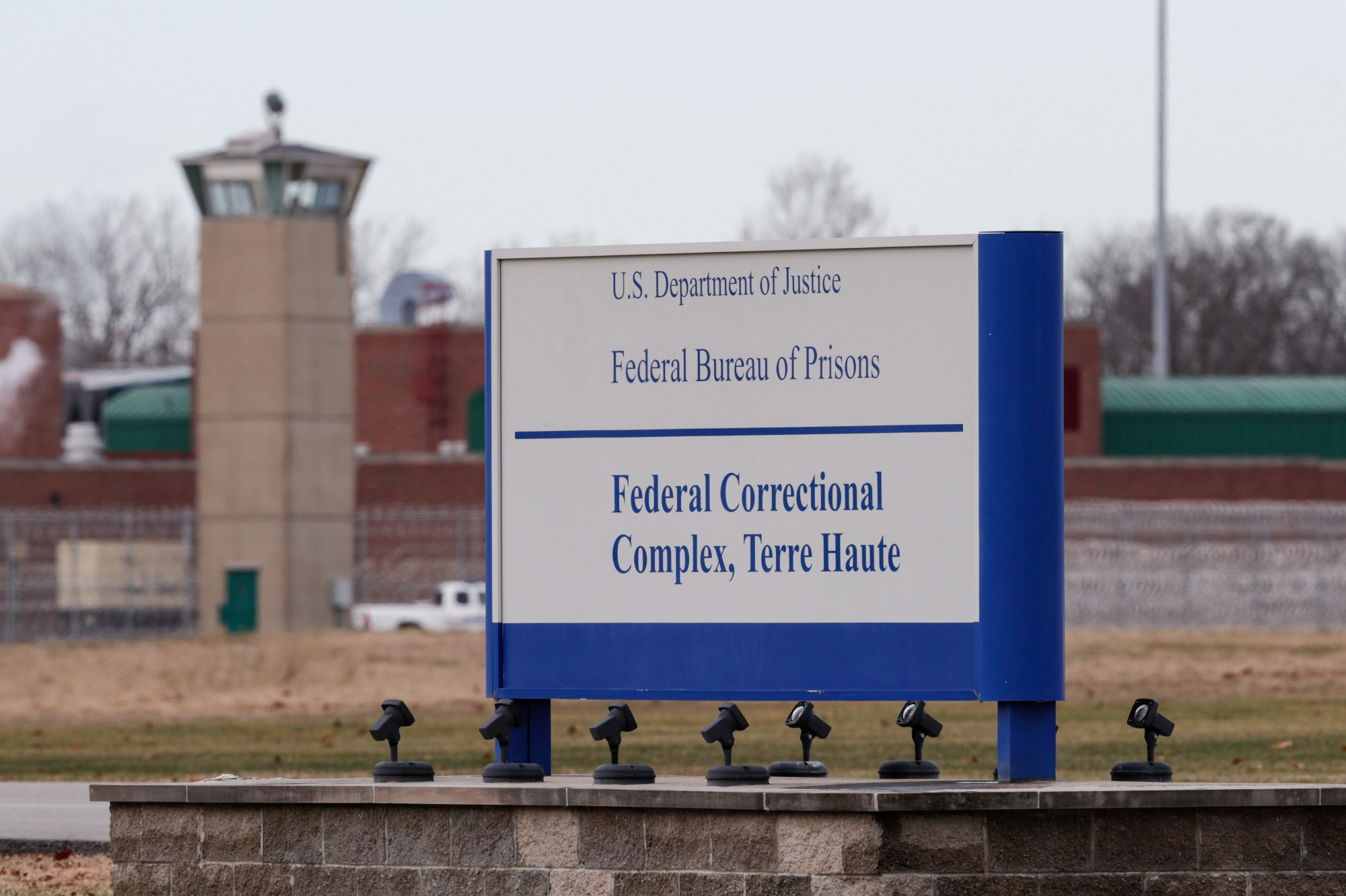 The guard tower flanks the sign at the entrance to the U.S. Penitentiary in Terre Haute, Ind. on Dec. 10, 2019. (AP Photo/Michael Conroy, File)