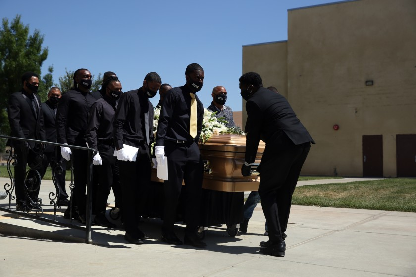 Pallbearers carry Robert Fuller's casket to the hearse at Living Stone Cathedral of Worship on Tuesday, June 30, 2020 in Little Rock, Calif. (Dania Maxwell / Los Angeles Times)