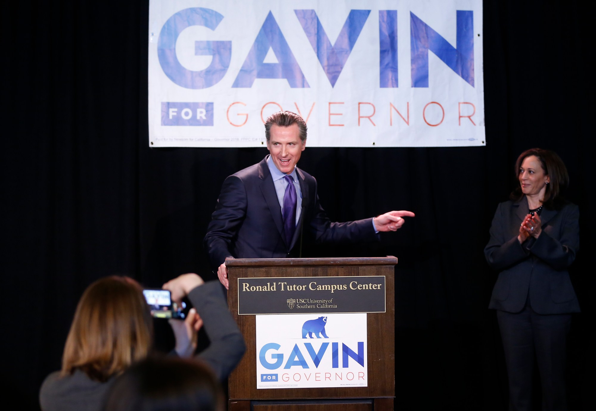 Sen. Kamala Harris, right, endorses California Lt. Gov. Gavin Newsom, left, for the 2018 California Governor's race at the Ronald Tutor Campus Center at the University of Southern California on Feb. 16, 2018. (Damian Dovarganes/Associated Press)