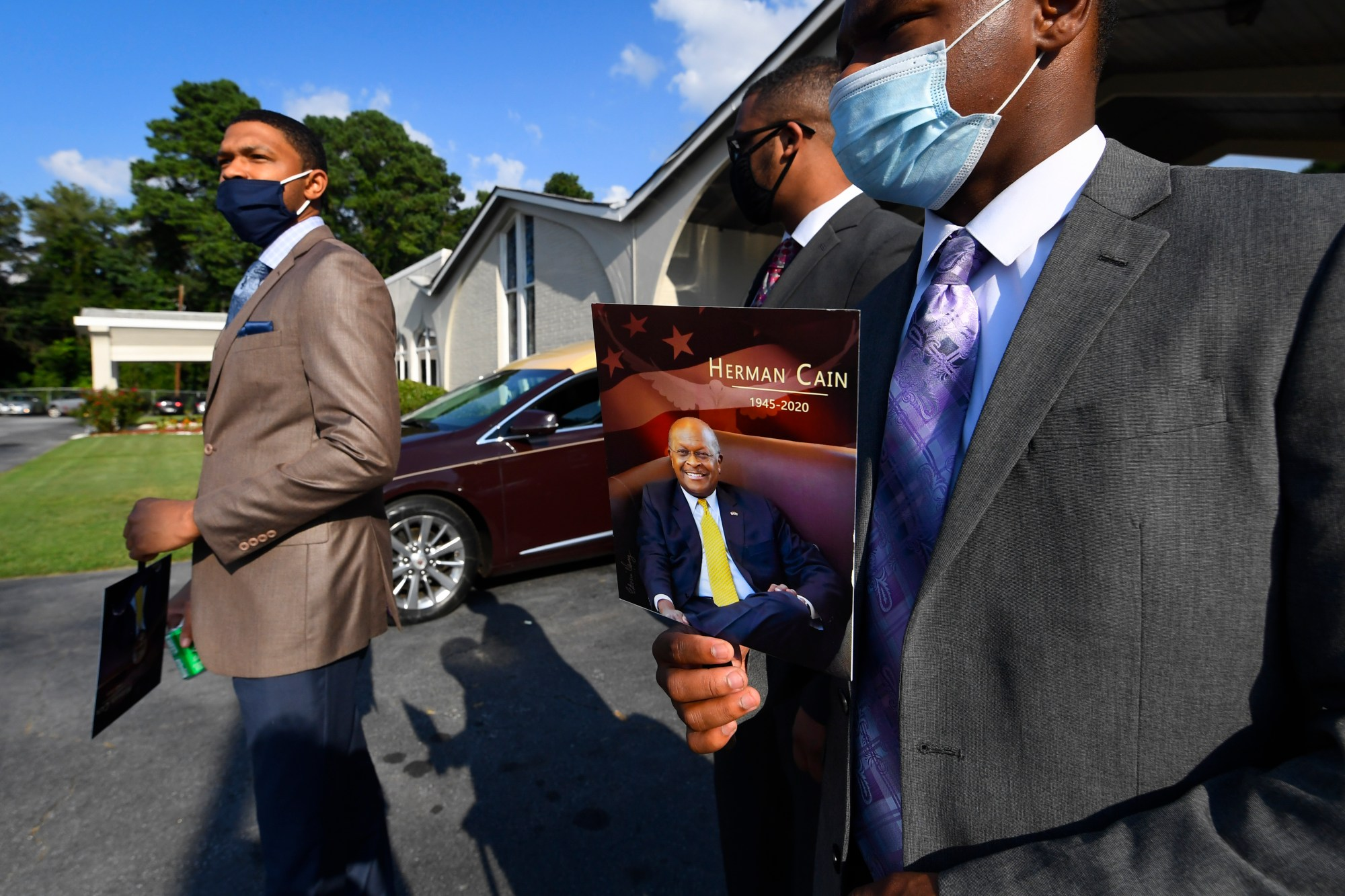 Attendees leave a public viewing for Herman Cain on Aug. 6, 2020, in Atlanta. (John Amis / Associated Press)