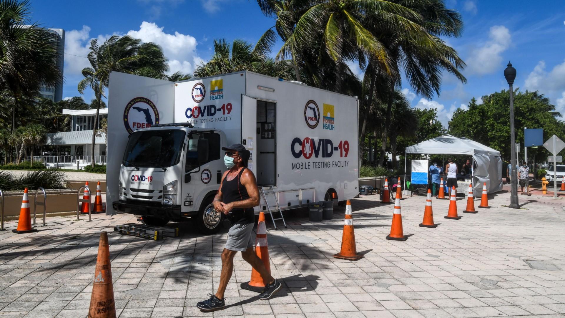 A man walks past the Aardvark Mobile Health's Mobile Covid-19 Testing Truck in Miami Beach, on July 24, 2020. (CHANDAN KHANNA/AFP/AFP via Getty Images)