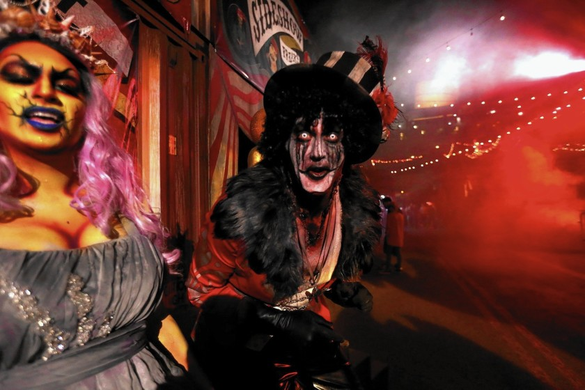 Oceana, left, and the Ring Master greet visitors to Dark Harbor, the annual Halloween festivity on the Queen Mary in Long Beach, in 2015. This year's event has been canceled. (Genaro Molina / Los Angeles Times)