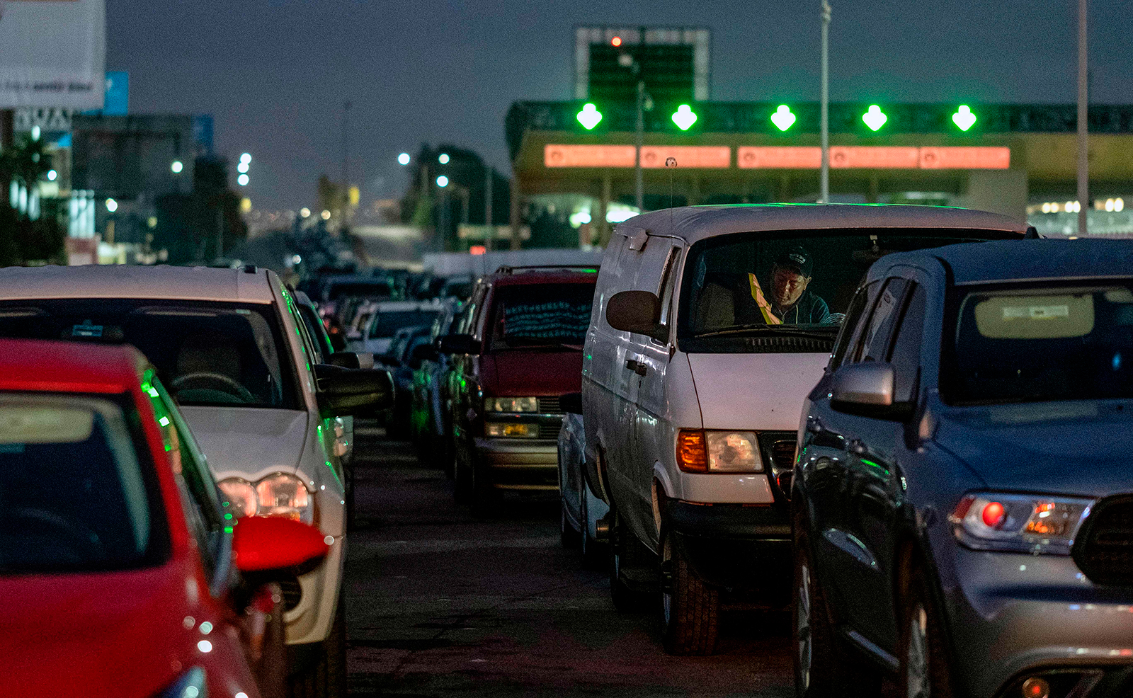 Commuters line up while waiting for the Otay Mesa Port of Entry to open to cross to the United States from Tijuana, Baja California state, Mexico, on early May 20, 2020. (GUILLERMO ARIAS/AFP via Getty Images)