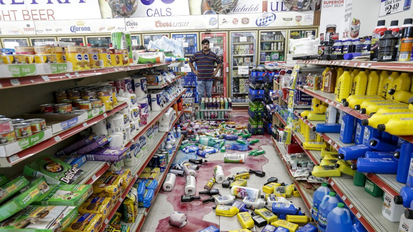 Javaid Waseem surveys the damage done at his Ridgecrest gas station by the July 5, 2019, earthquake in the Ridgecrest area. (Irfan Khan / Los Angeles Times)