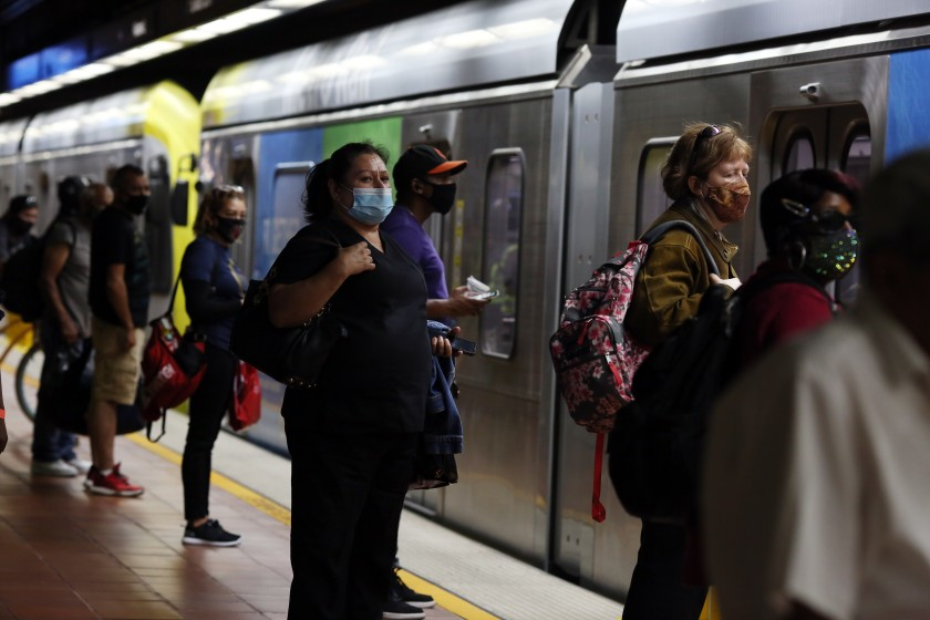 Transit riders wait for the A Line at the 7th Street/Metro Center station in downtown Los Angeles in July 2020. (Dania Maxwell / Los Angeles Times)