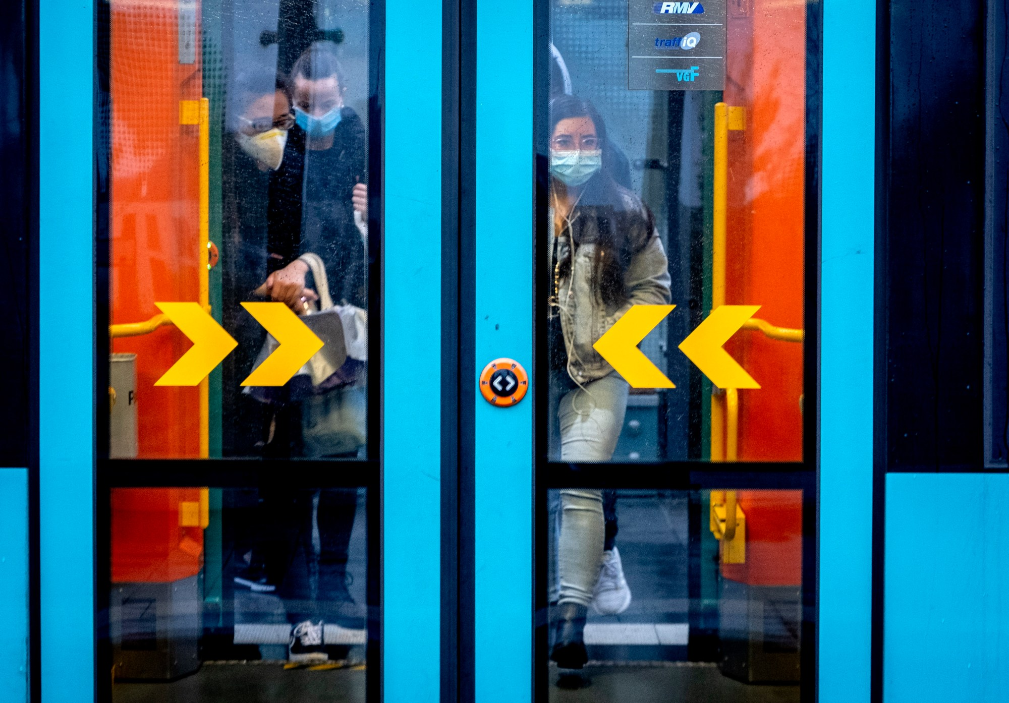 Passengers wear face mask mask as they enter a subway in Frankfurt, Germany on Oct. 28, 2020. (Michael Probst/Associated Press)