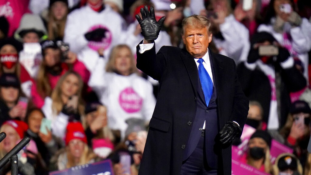 President Donald Trump waves after speaking at a campaign rally in Omaha, Neb., Tuesday, Oct. 27, 2020. (AP Photo/Nati Harnik)