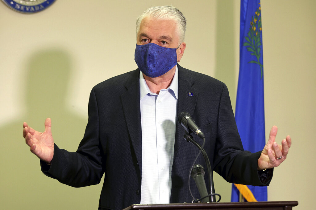 In this Friday, Oct. 2, 2020 file photo Nevada Gov. Steve Sisolak updates the state's COVID-19 response during a news conference at the Sawyer Building in Las Vegas. (K.M. Cannon/Las Vegas Review-Journal via AP, Pool, File)