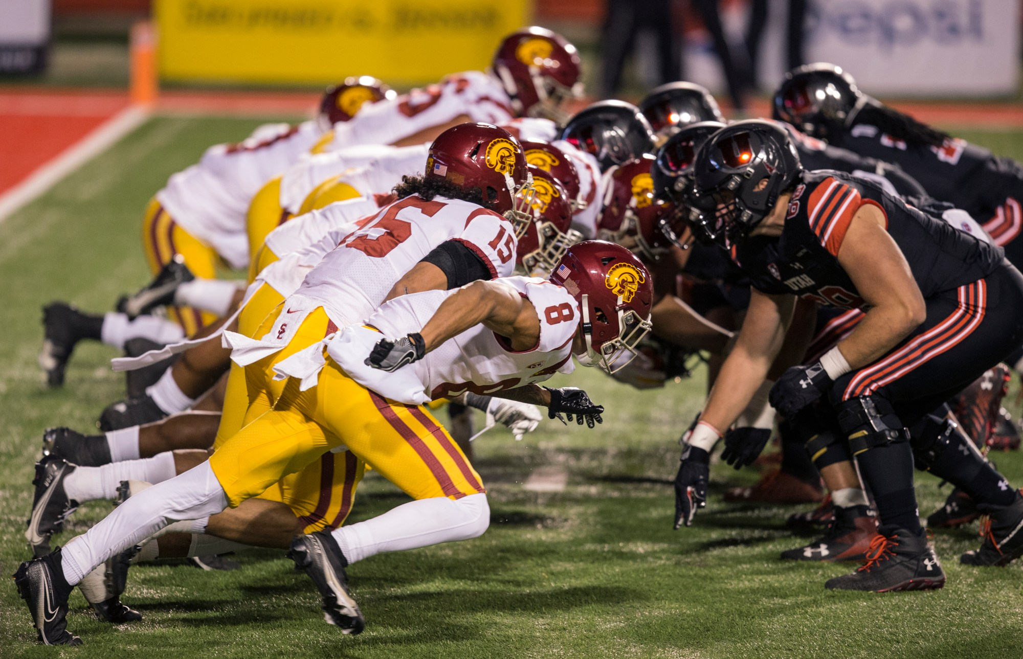 The lines of the Utah Utes and the USC Trojans clash after a snap during their game November 21, 2020 at Rice Eccles Stadium in Logan, Utah. (Chris Gardner/Getty Images)