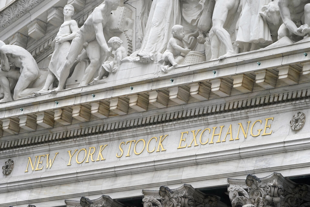 The sign is displayed at the New York Stock Exchange in New York, Monday, Nov. 23, 2020. (AP Photo/Seth Wenig)