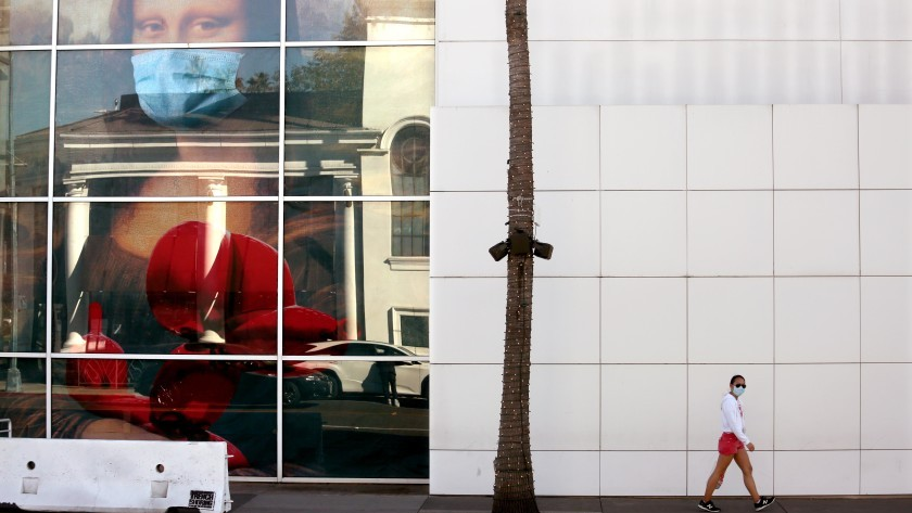 A pedestrian walks past a display at the Paley Center for Media in Beverly Hills on Tuesday.(Genaro Molina / Los Angeles Times)
