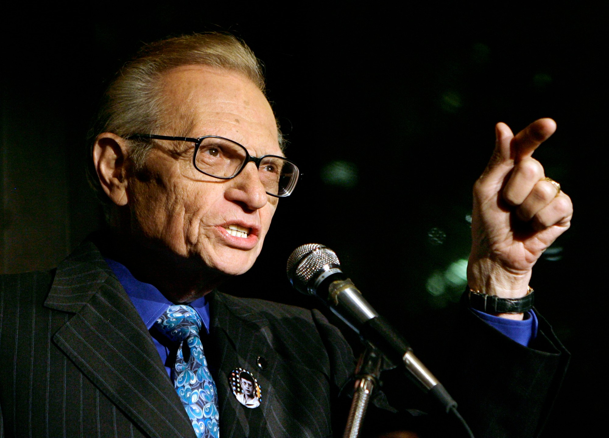 In this April 18, 2007 file photo, Larry King speaks to guests at a party held by CNN, celebrating King's fifty years of broadcasting in New York. (AP Photo/Stuart Ramson, File)