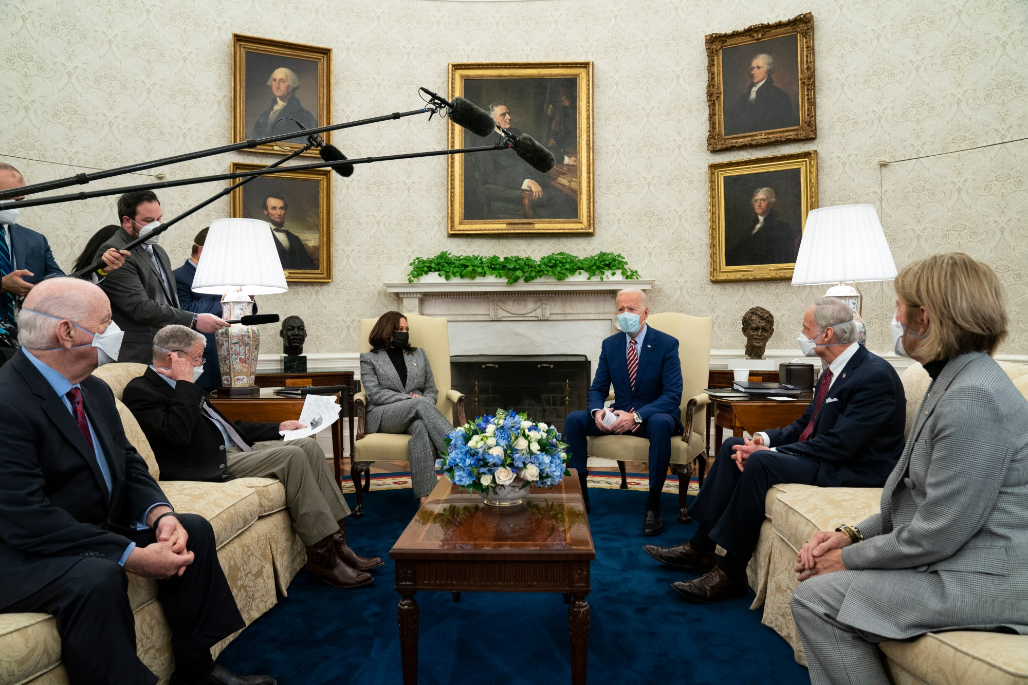 In this Feb. 11, 2021, file photo President Joe Biden speaks during a meeting with lawmakers on investments in infrastructure, in the Oval Office of the White House in Washington. From left, Sen. Ben Cardin, D-Md., Sen. Jim Inhofe, R-Okla., Vice President Kamala Harris, Biden, Sen. Tom Carper, D-Del., and Sen. Shelley Moore Capito, R-W.Va. Looking beyond the $1.9 trillion COVID relief bill, Biden and lawmakers are laying the groundwork for another of his top legislative priorities — a long-sought boost to the nation's roads, bridges and other infrastructure that could meet GOP resistance to a hefty price tag. (AP Photo/Evan Vucci, File)