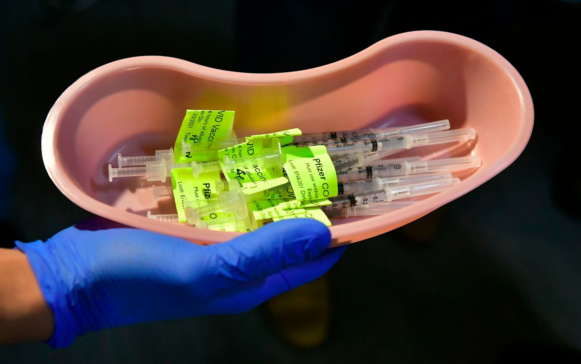 Syringes filled with the Pfizer COVID-19 vaccine are displayed on the opening day of a large-scale vaccination site at a parking structure in Pomona on Feb. 5, 2021. (FREDERIC J. BROWN/AFP via Getty Images)