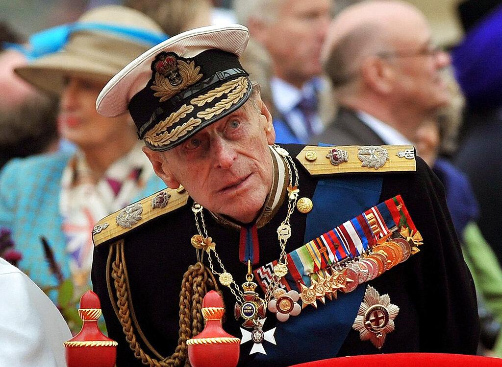 A Sunday June 3, 2012 photo from files showing Prince Philip watching the proceedings from the royal barge during the Diamond Jubilee Pageant on the River Thames in London. (AP Photo/John Stillwell, Pool File)