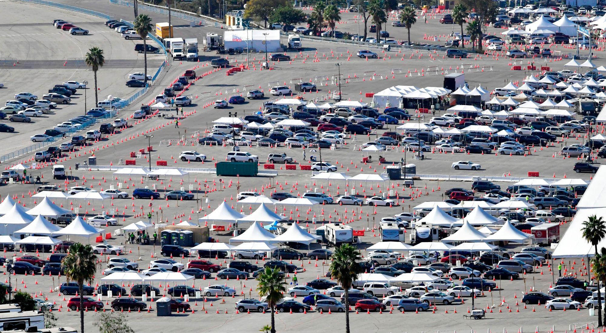 People in vehicles wait in line for their COVID-19 vaccine shot in the parking lot at Dodger Stadium on Feb. 25, 2021. (Frederic J. Brown / AFP / Getty Images)