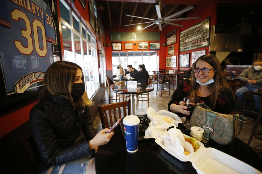 Brandi Harrapence, right, and daughter Kayla dine indoors at Firestone Grill in San Luis Obispo in this undated photo. The restaurant was open for indoor dining as San Luis Obispo County moved into a less restrictive tier of the state's reopening plan on March 2021. (Al Seib/Los Angeles Times)