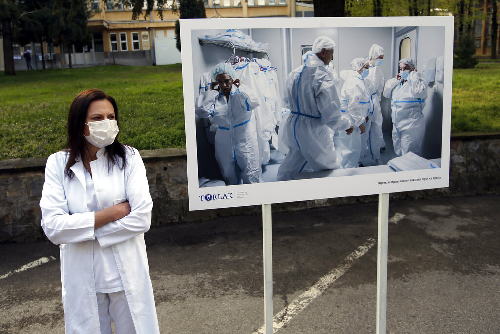 A Torlak Institute's employee waits for the visit of Serbian President Aleksandar Vucic in Belgrade, Serbia, Thursday, April 15, 2021. (AP Photo/Darko Vojinovic)