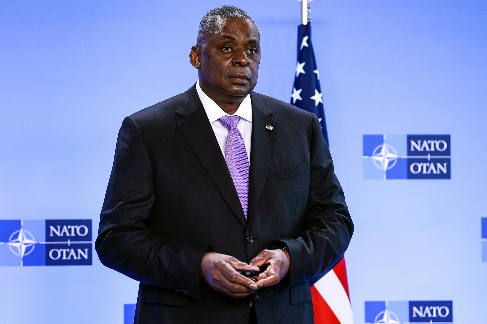 In this April 14, 2021, file photo, Secretary of Defense Lloyd Austin poses for photographers as he arrives at NATO headquarters in Brussels. The Associated Press has learned that a Pentagon panel is recommending that decisions to prosecute service members for sexual assault be made by independent authorities, not commanders. It would be a major reversal of military practice and a change long sought by Congress members. (Kenzo Tribouillard, Pool via AP)