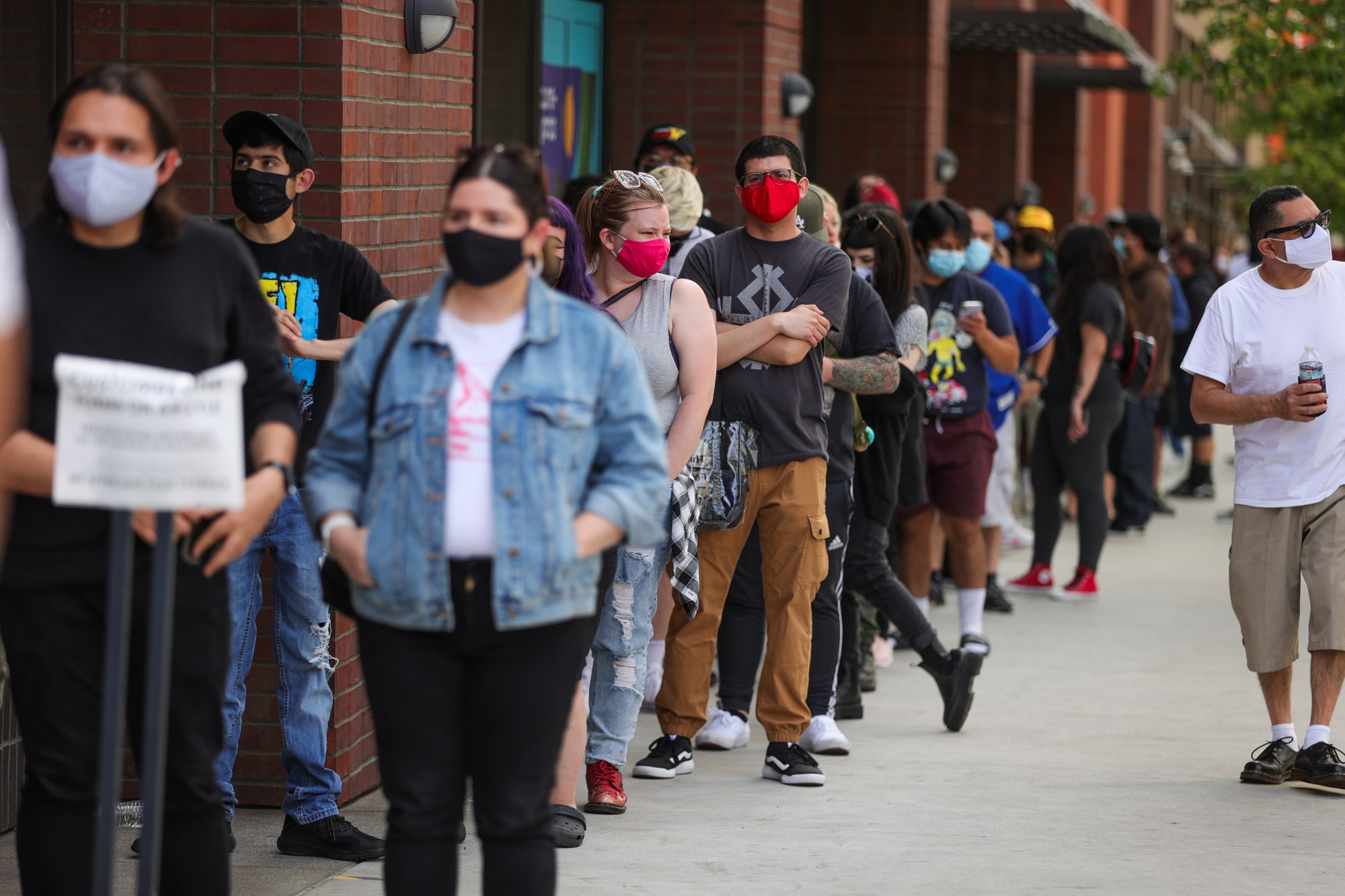 Customers wait in line to enter Amoeba Music during their grand re-opening at their new location on Hollywood Boulevard on April 1, 2021 in Los Angeles. (Rich Fury/Getty Images)