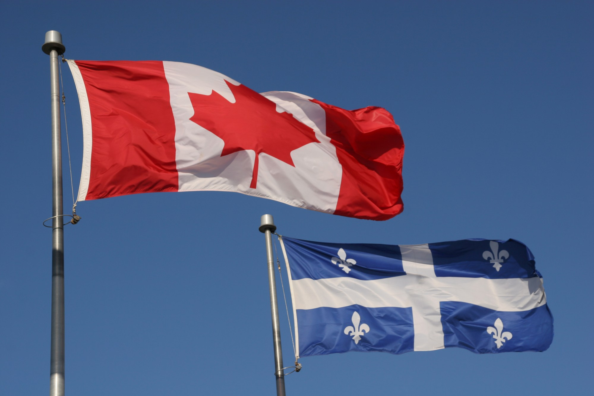 Canadian and Quebec provincial flags are seen in a file photo. (iStock/Getty Images Plus)