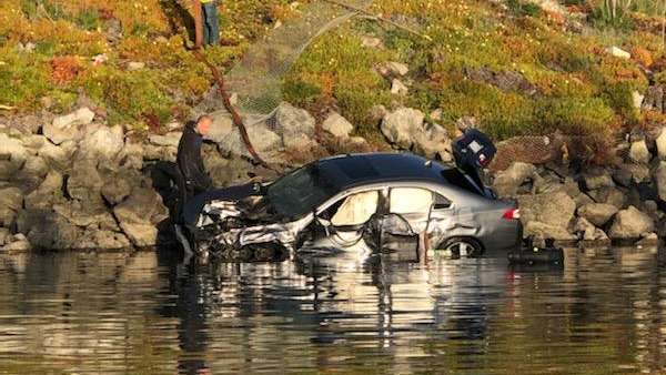 Authorities work to extricate victims after a car crashed into a river at the Moss Landing harbor in Monterey County on April 10, 2021, in a photo released by the Monterey County Sheriff's Office.