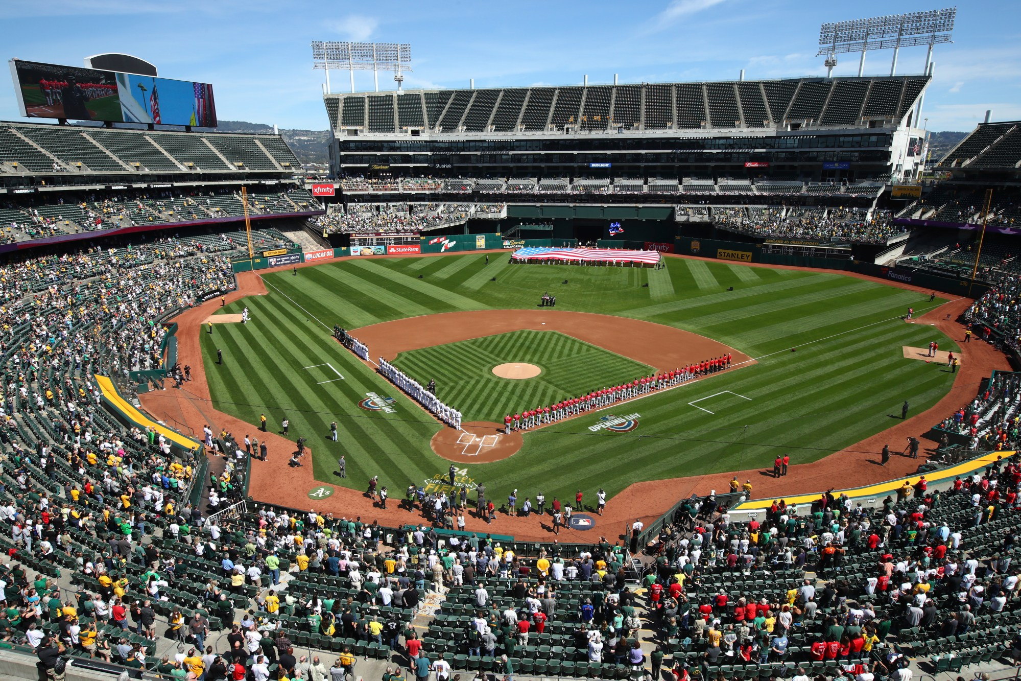 "The Los Angeles Angels and Oakland Athletics stand for the national anthem at the Oakland Coliseum prior to an opening day baseball game in Oakland, Calif., in this Thursday, March 29, 2018, file photo.Major League Baseball instructed the Athletics to explore relocation options as the team tries to secure a new ballpark it hopes will keep the club in Oakland in the long term. MLB released a statement Tuesday, May 11, 2021, expressing its longtime concern that the current Coliseum site is ""not a viable option for the future vision of baseball."" (AP Photo/Ben Margot, File)"