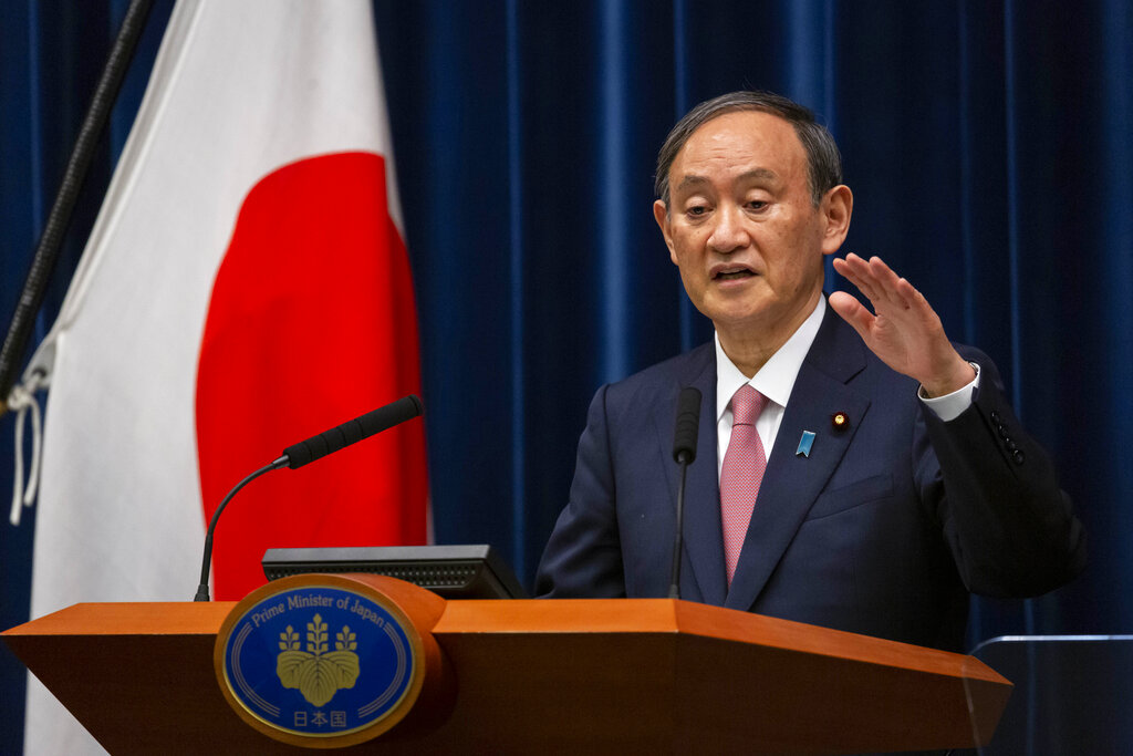 Japanese Prime Minister Yoshihide Suga speaks during a press conference at the prime minister's official residence on Friday, May 14, 2021, in Tokyo. (Yuichi Yamazaki/Pool Photo via AP)