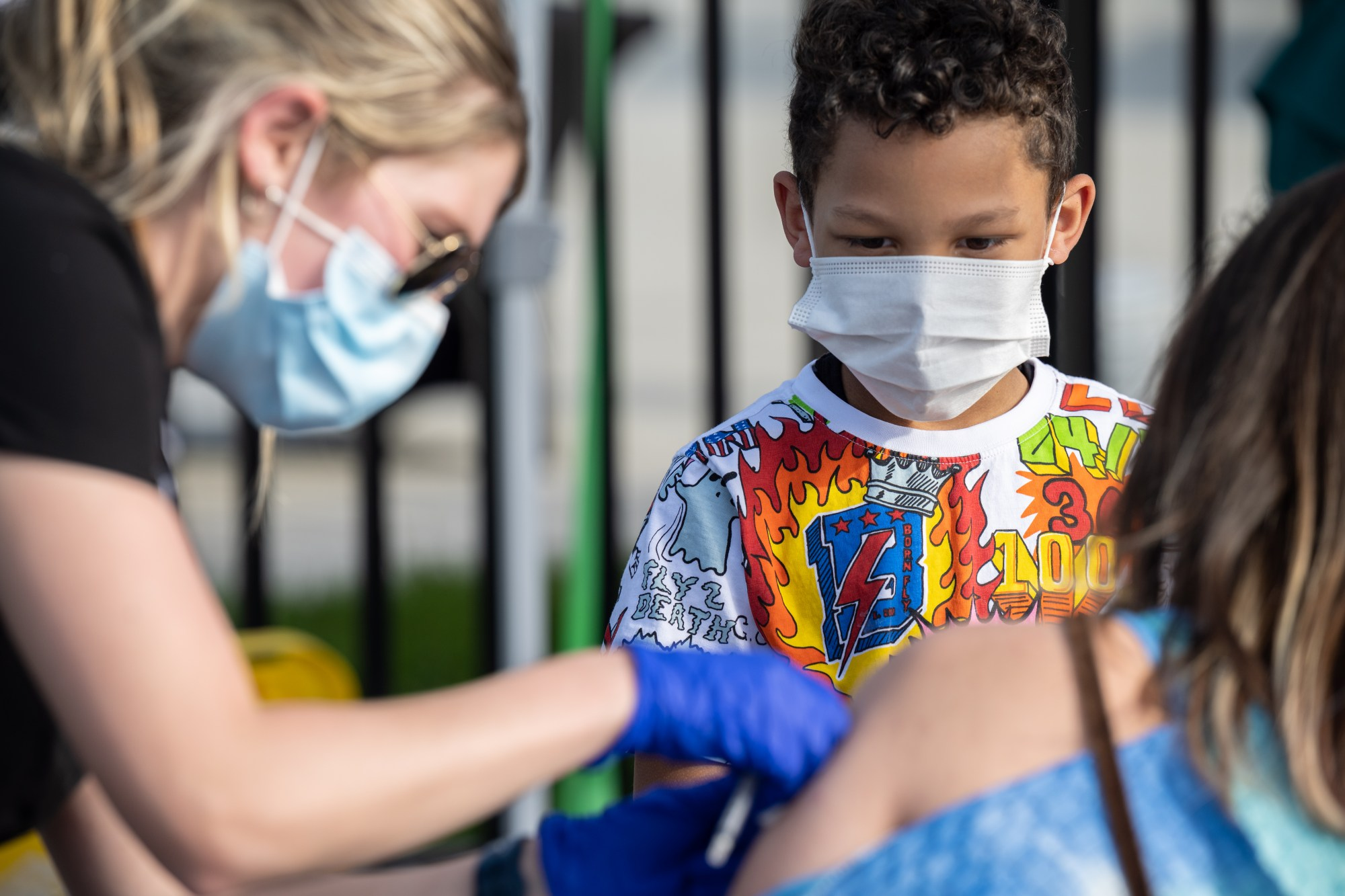 A child watches as a nurse administers a shot of COVID-19 vaccine during a pop-up vaccination event at Lynn Family Stadium on April 26, 2021, in Louisville, Kentucky. (Jon Cherry/Getty Images)