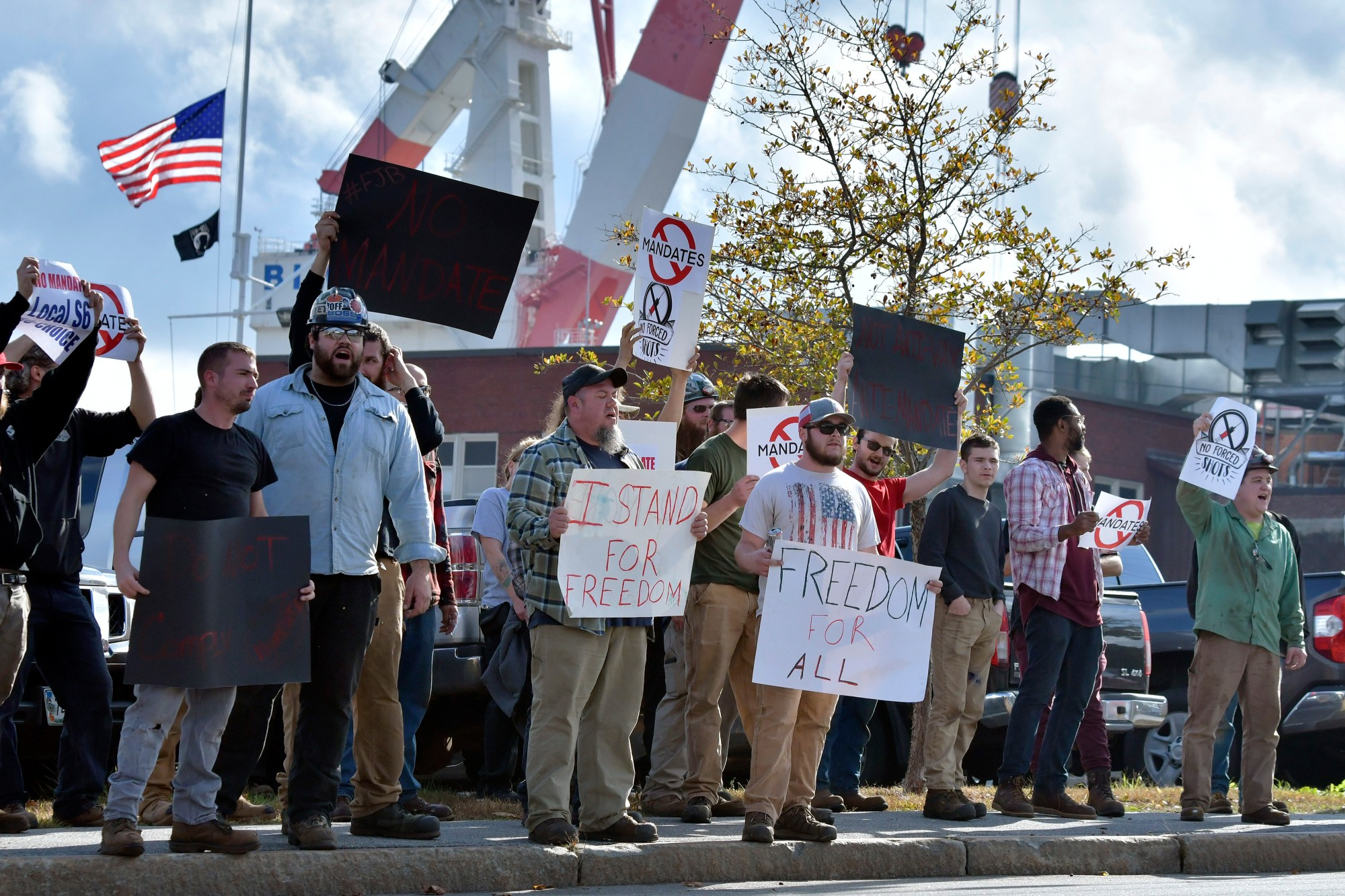 Employees at Bath Iron Works demonstrate against COVID-19 vaccine mandate outside the shipyard on Friday, Oct. 22, 2021, in Bath, Maine. (AP Photo/Josh Reynolds)