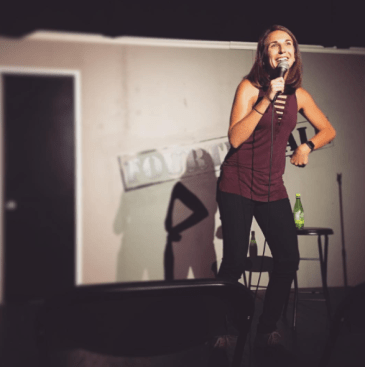 "Kaycee performing on her monthly show ""Inside Jokes"""
