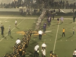 The Rattlers shake hands with the Hornets after the game. Photo by Jason Harris.