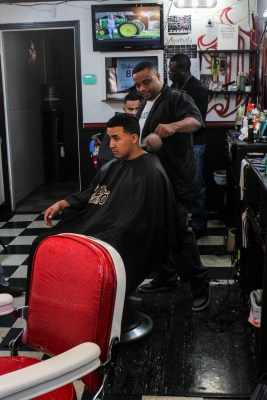 Danny Head brushes hair off of the back of a client's neck, after finishing his cut. Head is one of the Master Barbers one of the All-star Barbershop locations in San Marcos, which is on South LBJ. He has been cutting hair at the shop for about 4 years. Photo by DaLyah Jones.