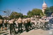 The state troopers standing and waiting for opportunities to help. (Women's March; 35mm Film)