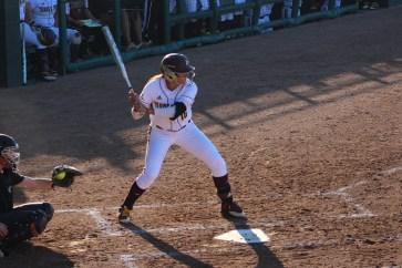Corrina Liscano ready to swing. Photo credited to renee dominguez