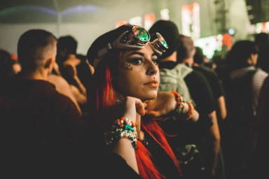 A fiery red-headed raver takes a break from dancing to Bassnectar on December 29, 2017.