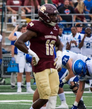 Texas State Bobcats #18 Frankie Griffin standing tall.