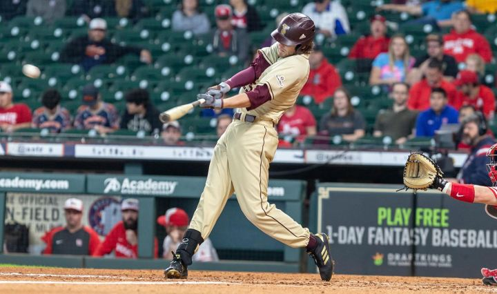Cole Coffey swings at a pitch thrown to him from the plate.