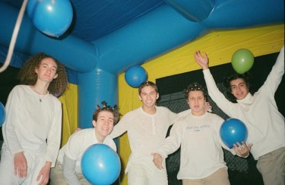 Members of LAUNDRY DAY in a bouncy house.