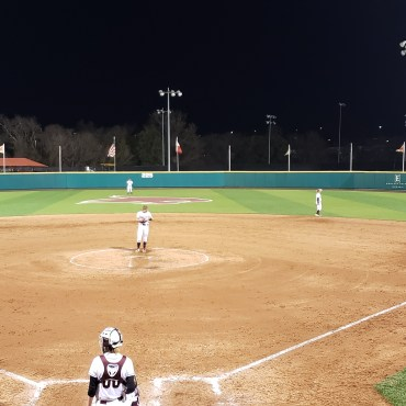 Texas State Softball on defense against Baylor University with several Texas State players on the field in position.