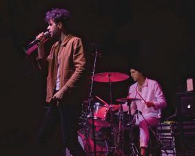 Man singing and man playing drums